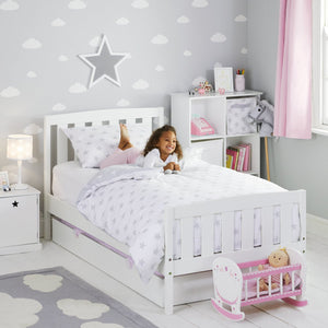 Children's wallpaper in grey with white clouds and a bed-side lamp in grey star.