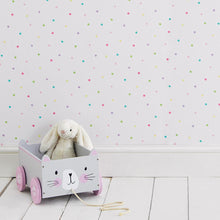 Children's wallpaper in white with multi-coloured spots and a grey star duvet cover set.