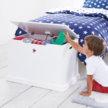 Star bright toy box with blankets and a navy star duvet cover set.