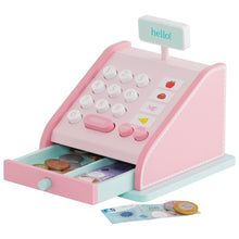 Wooden till in pink and play money for children.