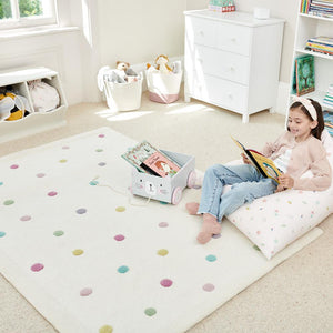 Confetti spot rug in beige with multicoloured spots.