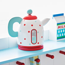 Wooden toy kettle in white, red and pale blue.