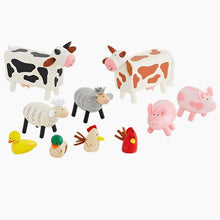 Wooden farm animals and a wooden toy farm.