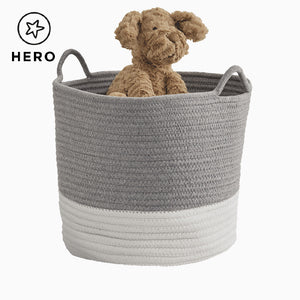 Rope storage basket in ivory & grey on a zigzag rug.