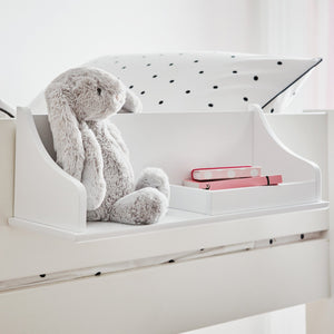 Clip-on bedside table in white with a cuddly toy rabbit.