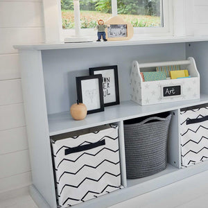 Storage shelf unit in cloud grey with a white desk organiser, zigzag storage cubes and a grey basket.