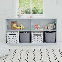Long shelf unit in cloud grey with storage cubes, children's toys and books.