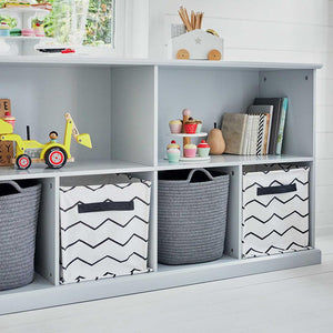 Various sizes of cube storage units in cloud grey filled with storage cubes and baskets.