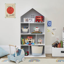 Large townhouse bookcase in white with children's books and wooden toys.