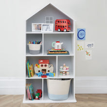 Large townhouse bookcase in white with children's books and toys.