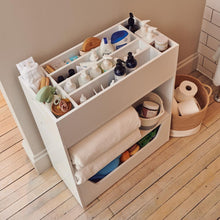 white stacking storage unit in bathroom