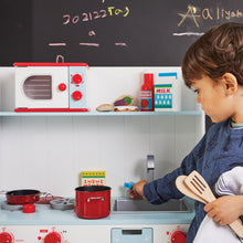 Wooden toy microwave and kitchen accessories for children.