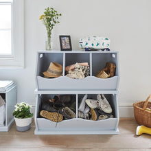 grey stacking storage trunk filled with shoes