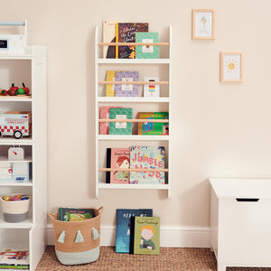 Greenaway skinny bookcase in white/ natural and children's books.
