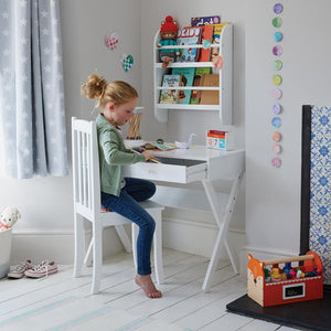 Faraday desk in white with children's books.
