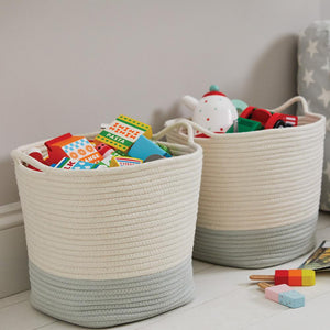 Rope storage baskets in sage and ivory with children's toys.