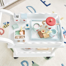 Time for tea trolley in white and wooden tea treats.
