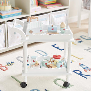 Time for tea trolley in white with a wooden tea set for children.