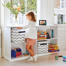 White, wooden storage shelf and zigzag storage cubes
