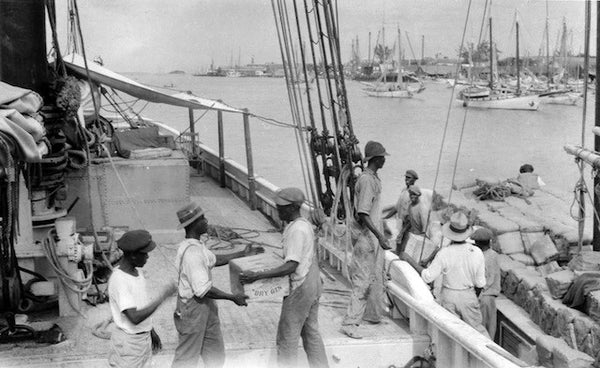 Workers loading the Arethusa in Nassau