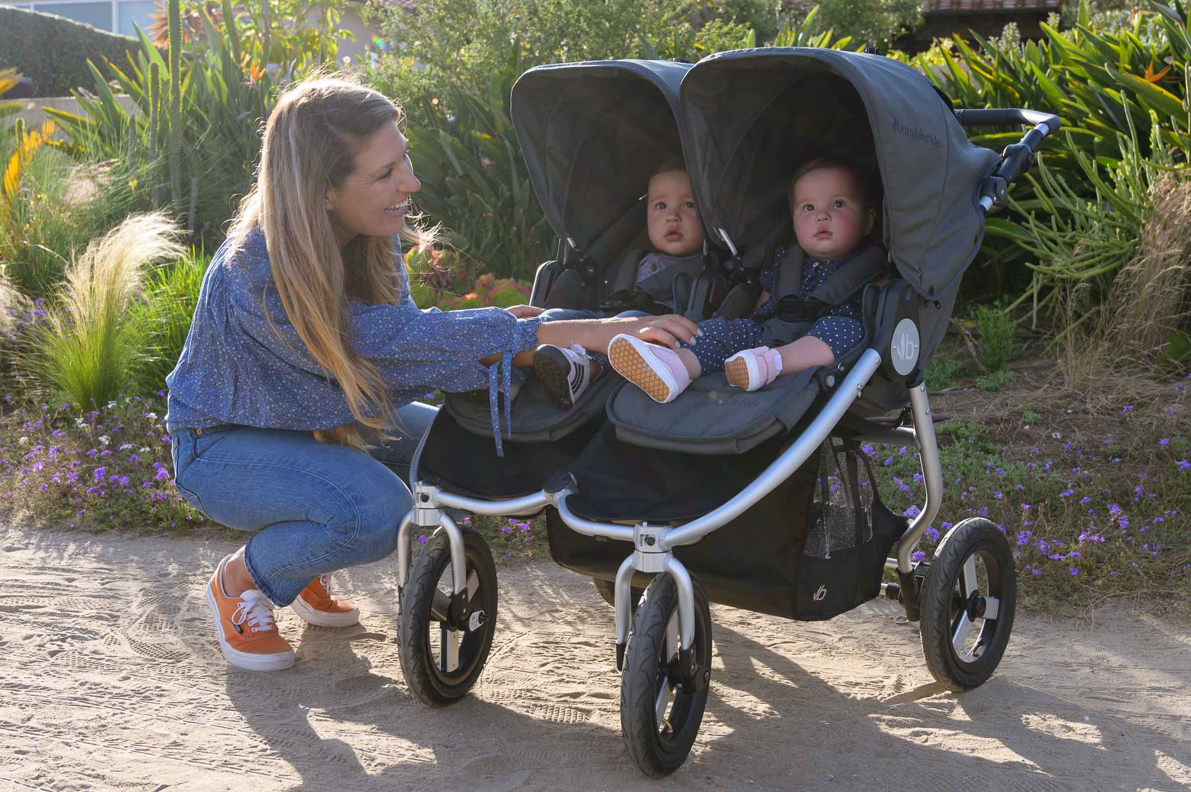 2020 Bumbleride Indie Twin double stroller in Dawn Grey with Twins on trail zoom