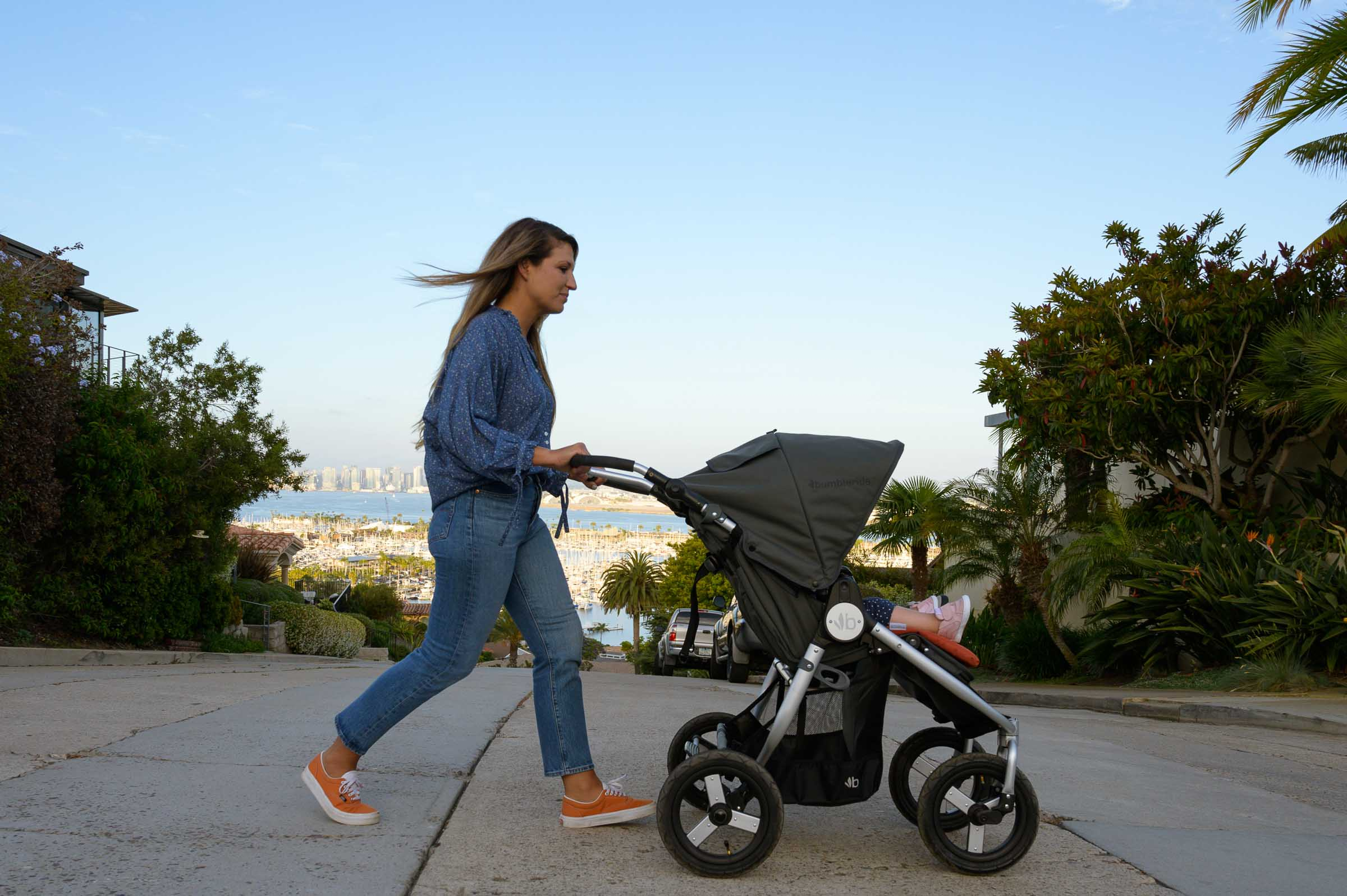 2020 Bumbleride Indie Twin stroller crossing street- Dawn Grey