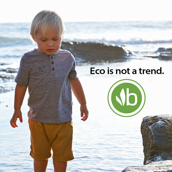 """Eco is not a trend"" quote on image of boy at beach at tidepools"