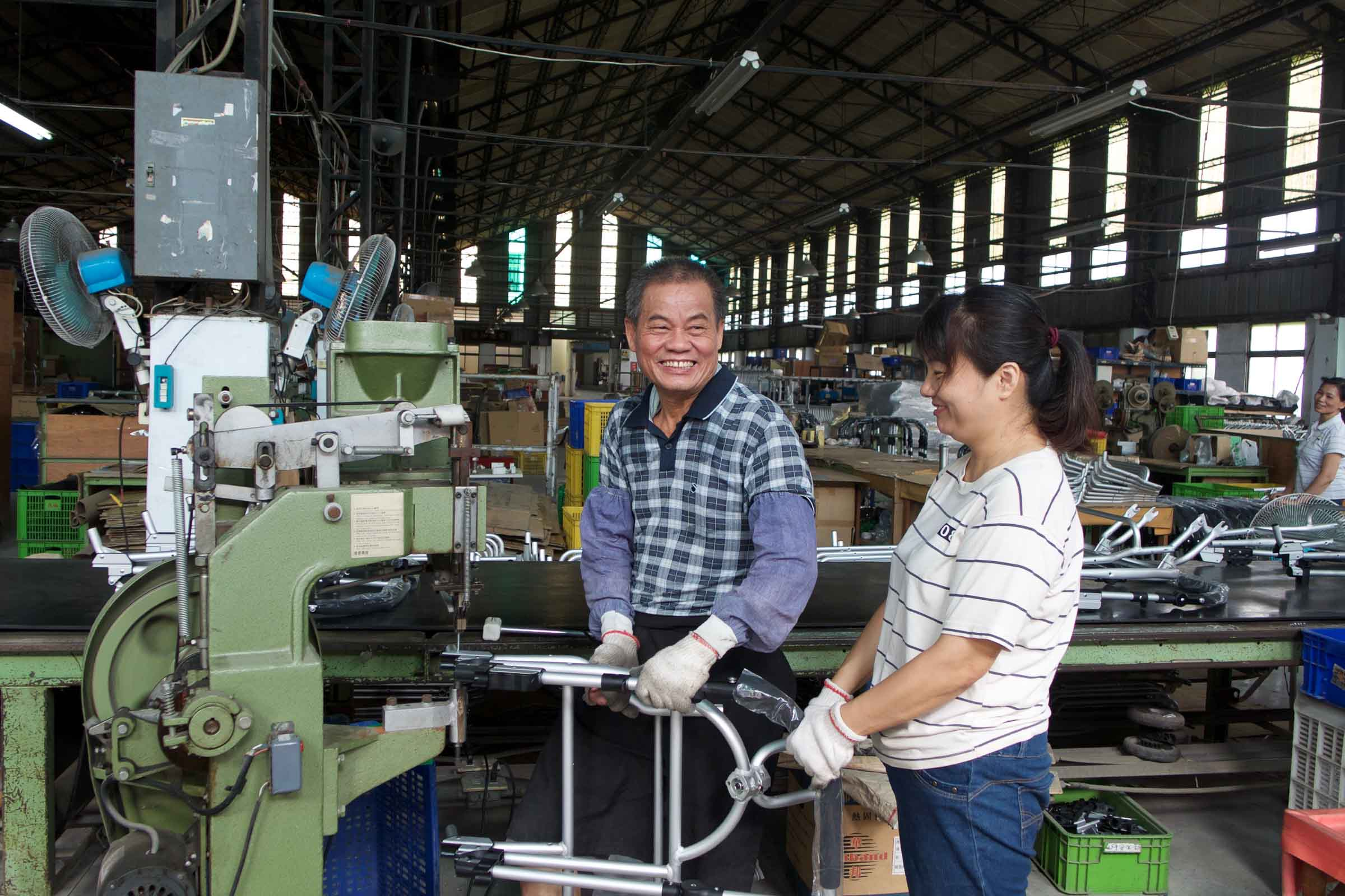 Bumbleride Factory Workers Smiling