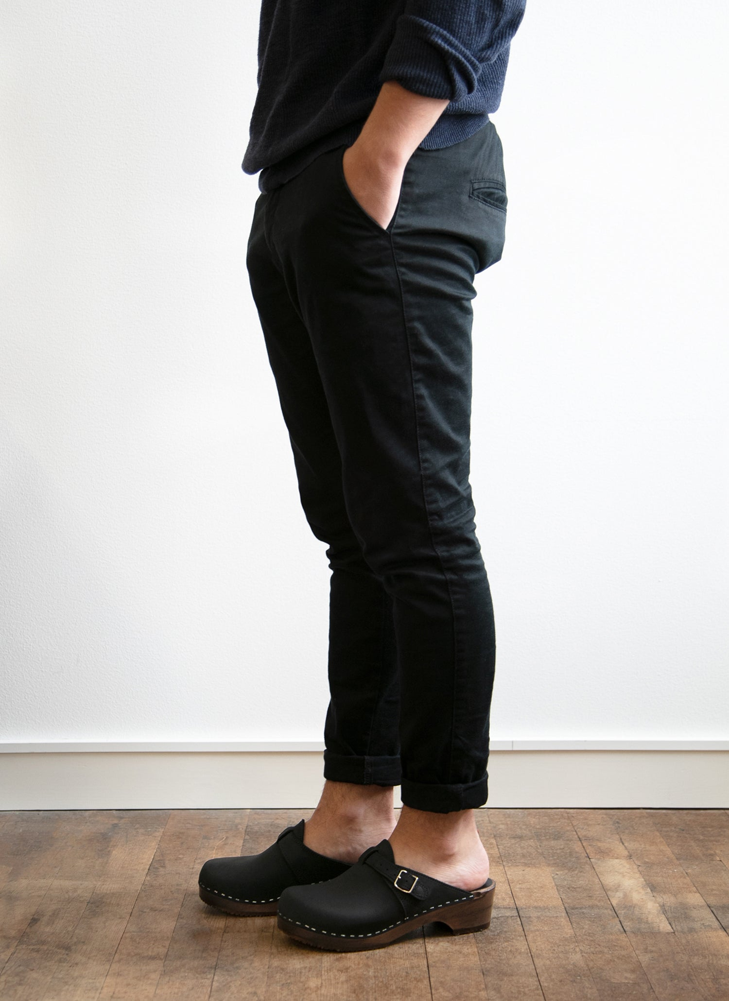 Man wearing black clogs