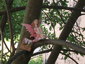 Fairy having a picnic in the trees