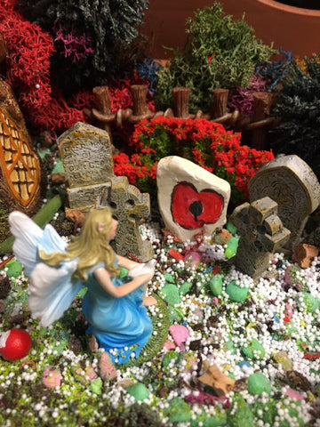 fairy kneeling at grave
