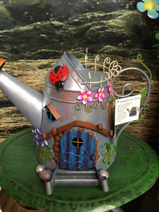 Metal watering can fairy house