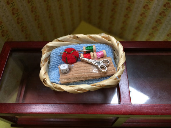 miniature basket of sewing accessories for fairies