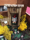 Gnome revealed in the outhouse