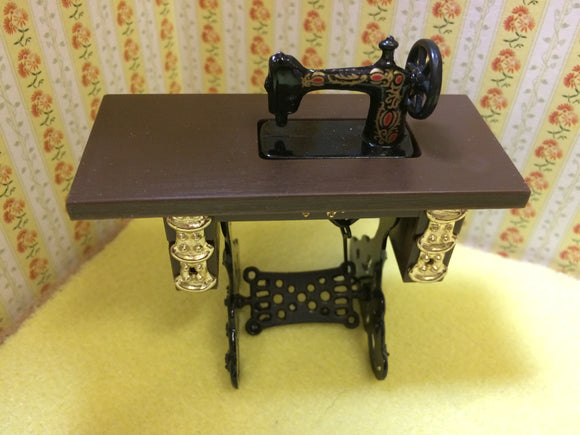 Purchase a tiny sewing machine