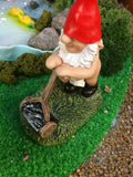 Gnome mowing lawn