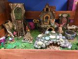 Fairy garden with pebbled well and bridge