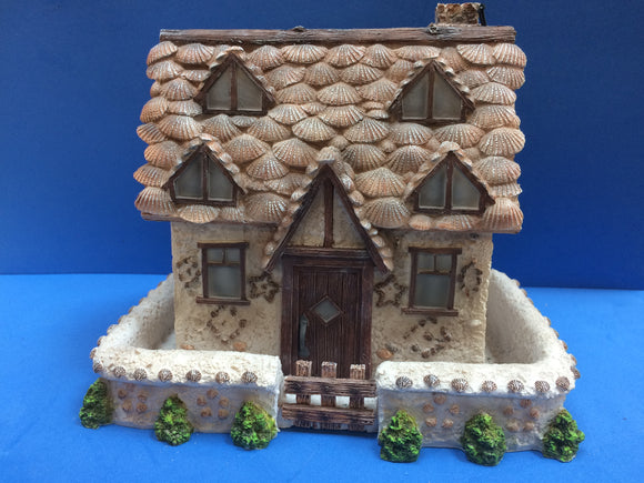 Pretty fairy house decorated with ceramic shells