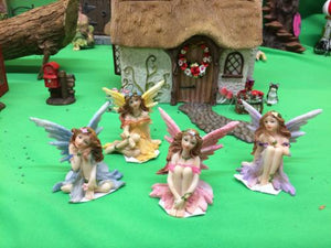 Four ceramic fairies