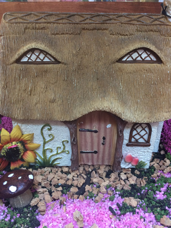 Thatched style fairy house