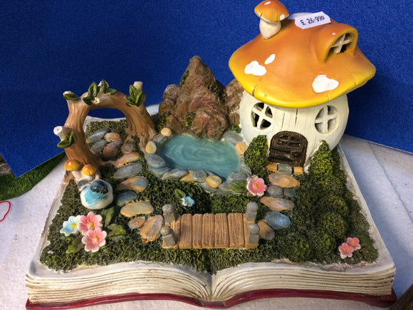 ceramic fairy scene displayed on fairy tale book