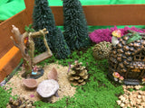 Log table in a small fairy garden