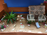 Seashell fairy house in a seaside themed garden