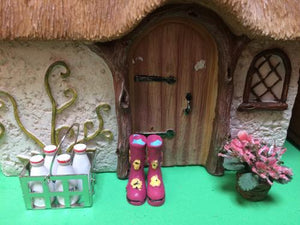 Fairy home with delivered milk and wellies outside