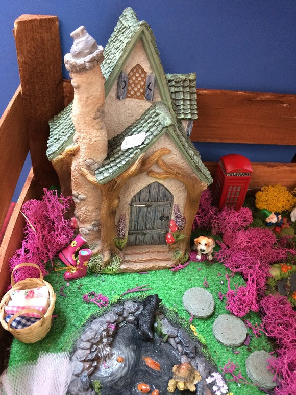 Woodland cottage fairy garden