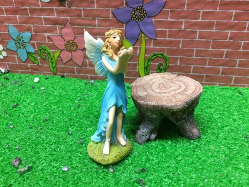 Standing ceramic fairy in blue dress