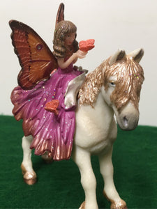 Fairy figure sitting on pony