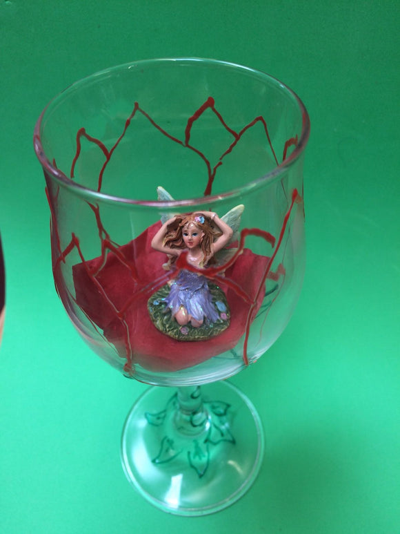Fairy figurine in a tulip wine glass