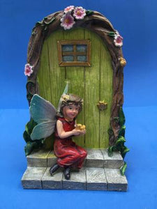 fairy door with fairy sitting on steps