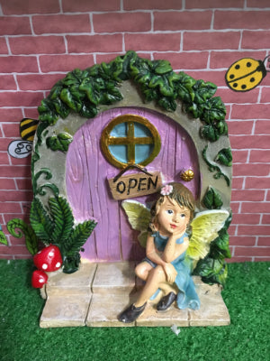 Purple door with sitting fairy